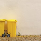 Two Yellow Recycle Bins on the Street